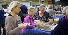 Snowstorm doesn't deter hundreds of volunteers packing meals