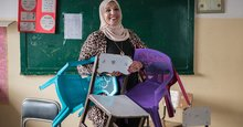 This school principal is helping Syrian refugee girls, one chair at a time