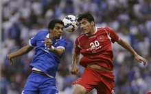 Soccer-Iran clubs threaten to quit Champions League over Saudi row
