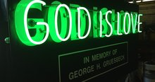 Landmark 'God is love' neon sign house for sale
