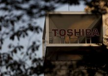 Toshiba in $5.9 billion asset sale, shares hit by report of U.S. probe