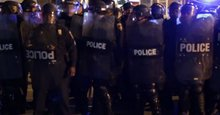 Video: Baltimore protesters defy curfew, stand off with police