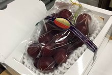 Bunch of Grapes Sells for Record $8,200