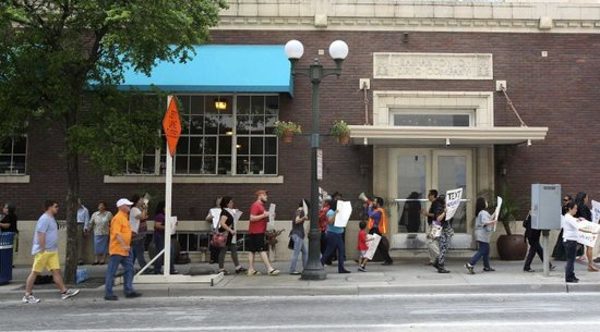 Rally at downtown hotel protests property tax system