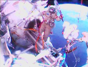 Russia | Spacewalking cosmonauts above planet Earth relay the Olympic torch